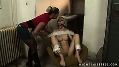 Petite blonde lays helpless as she's teased by her hot mistress