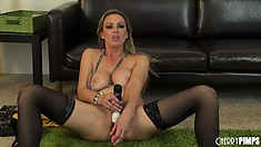 Gorgeous blonde in black stockings attacks her pussy with a dildo