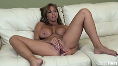 Passionate vixen Amber Lynn Bach masturbates tenderly on a big bed