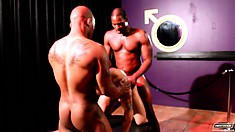 These two black gays are pounding the white dude from each end