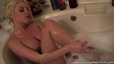 Sexy blonde takes a bath unaware that her home has been invaded