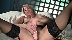 Sexy blond MILF rides her big fake cock, she cums all over it