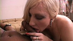 Mature blonde bitch sucks on a big black dick to get some jizz