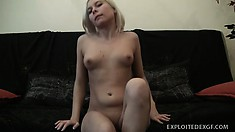 Adorable blonde with perky tits and a hot ass Lisa feeds her peach a blue dildo