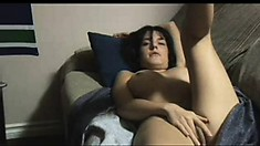 Hot MILF shows off her body as she goes around her home naked