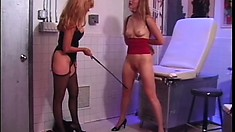 Saucy dominatrix punishes a naughty hot blonde piece of tail