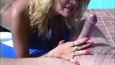 Big-jugged blonde is trampled under two studs during DP scene