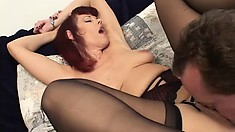 This redheaded MILF trades her dildo for two hard cocks to fuck