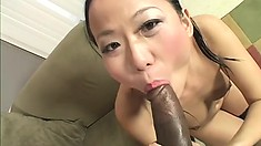 Asian chick stretches her pussy with a dildo so his cock fits easier