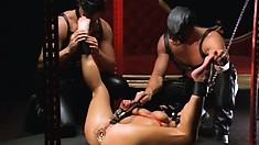 Slave tortured up the ass, gets nipples and cunt lips clipped by masters