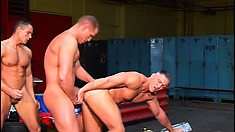 Three horny bikers with muscled bodies engage in hardcore anal sex