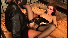 Kinky babe in latex Olga gets fucked by a masked stud in the dungeon