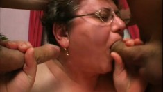 Short haired mature lady with huge tits Cathy gets pounded by two guys