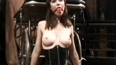 The pleasure of pain, using a ball gag, a whip and clips on her tits
