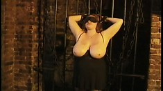 Huge titted redhead gets tied up to take some nasty punishment